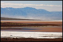 Salt Flats on Valley floor and Owlshead Mountains, early morning. Death Valley National Park, California, USA.