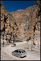Cars in narrows, Titus Canyon. Death Valley National Park, California, USA. (color)