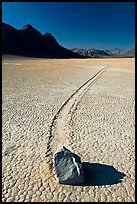 Sailing rock and travel groove on the Racetrack. Death Valley National Park, California, USA. (color)