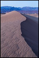 Dune ridge and Amargosa Range at dusk. Death Valley National Park ( color)
