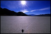 Moving rock on the Racetrack, mid-day. Death Valley National Park, California, USA.