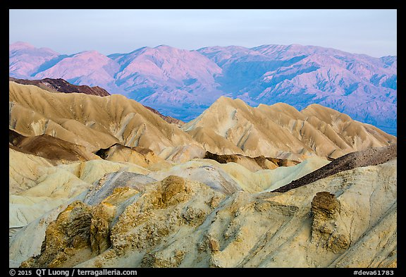 Badlands and mountains at sunrise, Twenty Mule Team Canyon. Death Valley National Park (color)