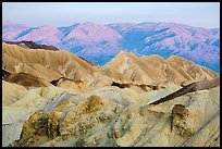 Badlands and mountains at sunrise, Twenty Mule Team Canyon. Death Valley National Park ( color)