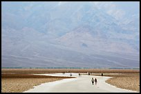 Tourists walking onto Salt Pan at Badwater. Death Valley National Park ( color)