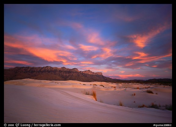 White sand dunes, Guadalupe range, and clouds at sunset. Guadalupe Mountains National Park, Texas, USA.