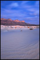 Gypsum sand dunes and Guadalupe range at sunset. Guadalupe Mountains National Park, Texas, USA.