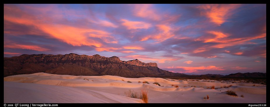 White sand dunes, mountain range, and colorful clouds. Guadalupe Mountains National Park (color)