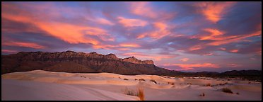 White sand dunes, mountain range, and colorful clouds. Guadalupe Mountains National Park, Texas, USA.