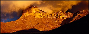 Cliffs and clouds illuminated by low sun. Guadalupe Mountains National Park, Texas, USA.