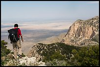 Hiker walking on Guadalupe Peak. Guadalupe Mountains National Park, Texas, USA. (color)