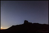 Stars above El Capitan at night. Guadalupe Mountains National Park, Texas, USA. (color)