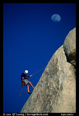 Climber rappelling down with moon. Joshua Tree National Park (color)