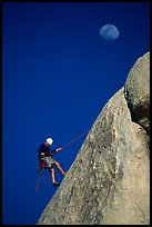 Climber rappelling down with moon. Joshua Tree National Park ( color)