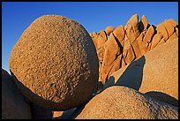 Round and triangular Boulders, Jumbo Rocks campground, sunset. Joshua Tree National Park, California, USA.