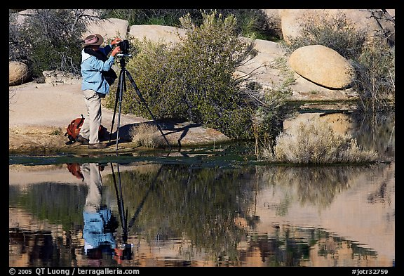 Photographer with large format camera at Barker Dam. Joshua Tree National Park, California, USA.