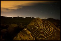Petroglyphs on Signal Hill and Tucson Mountains at night. Saguaro National Park, Arizona, USA.