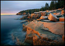 Granite slabs and Otter Point at sunrise. Acadia National Park, Maine, USA. (color)