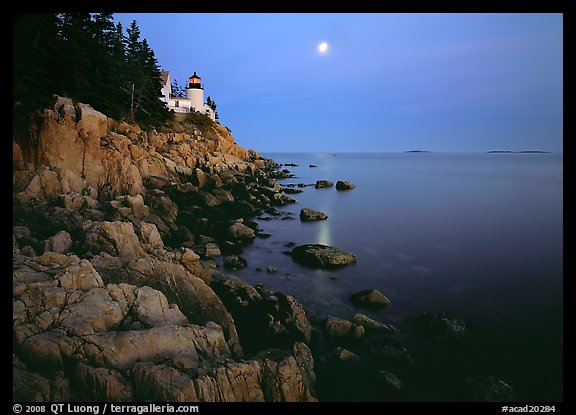 Bass Harbor Lighthouse, moon and reflection. Acadia National Park, Maine, USA.