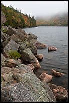 Rocky shore in autumn, Jordan Pond. Acadia National Park, Maine, USA.