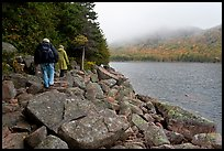 Hikers on shore of Jordan Pond. Acadia National Park, Maine, USA.