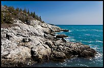 Rocky coast and blue waters, Isle Au Haut. Acadia National Park, Maine, USA.