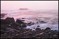 Boulders and ocean, foggy sunrise. Acadia National Park, Maine, USA.