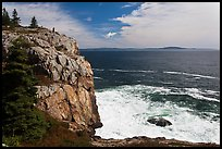 Tall granite sea cliff with person standing on top. Acadia National Park ( color)
