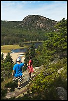 Hikers above Sand Beach. Acadia National Park, Maine, USA. (color)