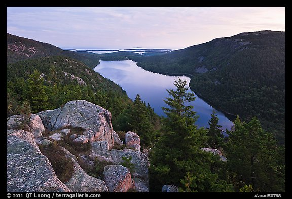 Forested hills and Jordan pond from above at dusk. Acadia National Park, Maine, USA.