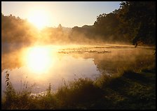 Sun shining through mist, Kendall Lake. Cuyahoga Valley National Park, Ohio, USA.