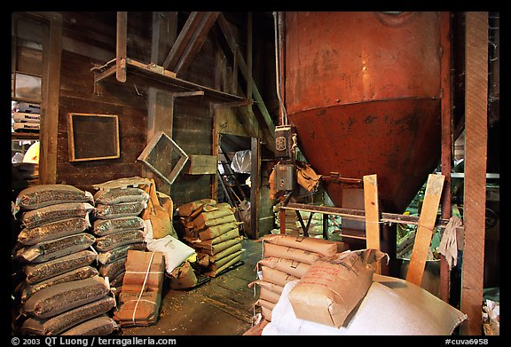 Grain distributor and bags of  seeds in Wilson feed mill. Cuyahoga Valley National Park (color)