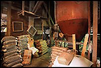 Grain distributor and bags of  seeds in Wilson feed mill. Cuyahoga Valley National Park, Ohio, USA. (color)