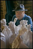 Miller sitting behind bags of cornmeal, North Carolina. Great Smoky Mountains National Park ( color)