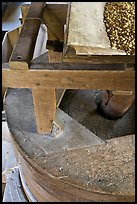 Corn being grinded into flour, Mingus Mill, North Carolina. Great Smoky Mountains National Park, USA.