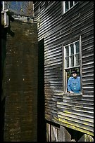 Miller standing at window, Mingus Mill, North Carolina. Great Smoky Mountains National Park, USA.