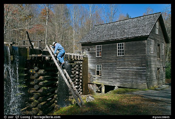 Miller climbing onto millrace, Mingus Mill, North Carolina. Great Smoky Mountains National Park, USA.