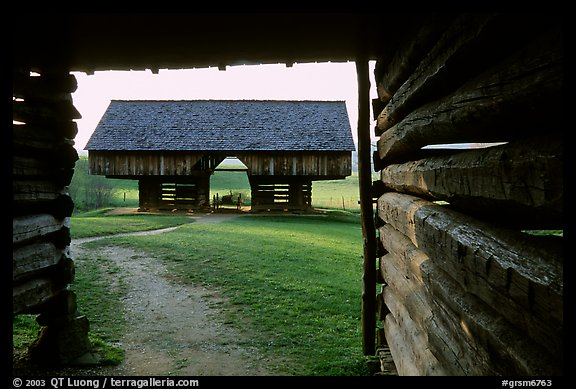 Cantilever barn framed by doorway, Cades Cove, Tennessee. Great Smoky Mountains National Park, USA.