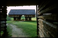 Cantilever barn framed by doorway, Cades Cove, Tennessee. Great Smoky Mountains National Park, USA. (color)