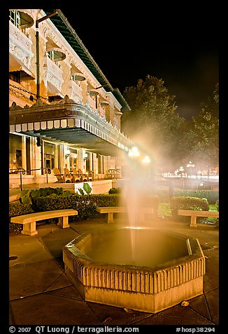 Fountain with thermal steam outside Fordyce Bath at night. Hot Springs National Park (color)