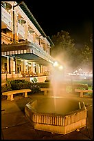 Fountain with thermal steam outside Fordyce Bath at night. Hot Springs National Park, Arkansas, USA.