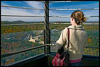 Visitor looking at the view from Hot Springs Mountain Tower in the fall. Hot Springs National Park, Arkansas, USA.