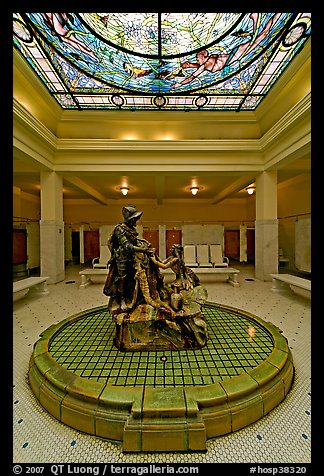 Statue of Desoto receiving gift from Caddo Indian maiden in mens bath hall. Hot Springs National Park (color)