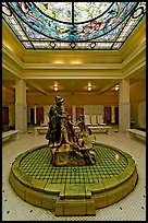 Statue of Desoto receiving gift from Caddo Indian maiden in mens bath hall. Hot Springs National Park, Arkansas, USA.