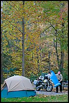 Tent and motorcycle camper under trees in fall colors. Hot Springs National Park, Arkansas, USA.