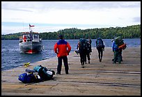 Backpackers waiting for pick-up by the ferry at Windego. Isle Royale National Park, Michigan, USA. (color)