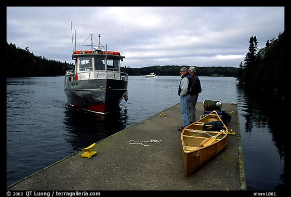 Canoists waiting for pick-up by the ferry at Chippewa harbor. Isle Royale National Park (color)