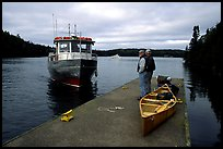 Canoists waiting for pick-up by the ferry at Chippewa harbor. Isle Royale National Park, Michigan, USA. (color)