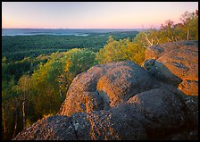 Mount Franklin granite outcrop and distant Lake Superior at sunset. Isle Royale National Park, Michigan, USA.