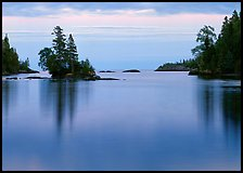 Tree-covered islet and smooth waters, Chippewa Harbor. Isle Royale National Park ( color)