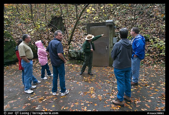 Ranger pointing to cave entrance to tourists. Mammoth Cave National Park (color)